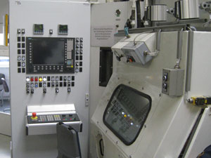 CNC control cabinet of a wet blasting machine